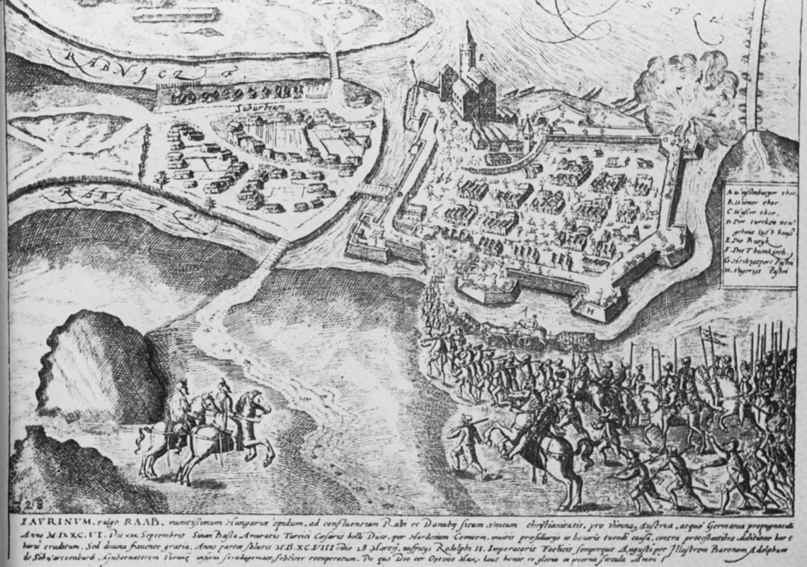 """A 17. század elején készült mozgalmas metszet Győr visszafoglalását ábrázolja. A támadók a kaput robbantják be, a védők (később) a lőportornyot. De most számunkra a vártól délkeletre (balra) eső, a """"Suburbum""""-ba, a külvárosba a Rábán átvezető híd ábrázolása az érdekes. (forrás: borbíró-Valló)"""